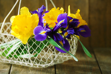 Beautiful spring flowers in wicker metal basket