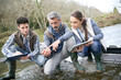 Biologist with students in science testing river water - 80534105