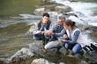 Biologist with students in science testing river water - 80534330