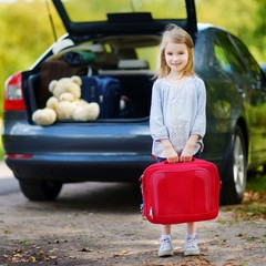 Adorable little girl with a suitcase