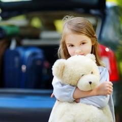 Adorable little girl with big teddy bear