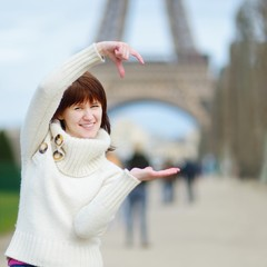 Beautiful young woman sightseeing in Paris
