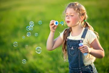 Kid in a green field