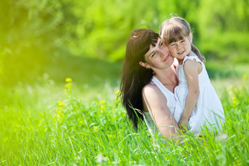 mother with her daughter in nature