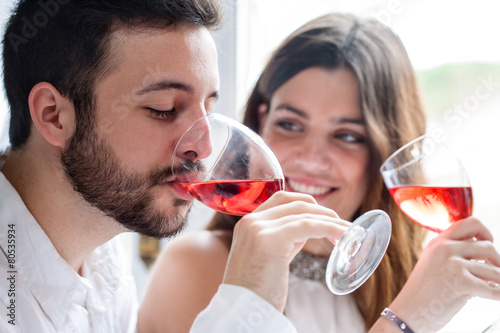 Couple enjoying wine tasting.