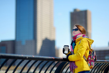 Beautiful young woman drinking coffee in New York