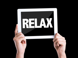 Tablet pc with text Relax isolated on black background