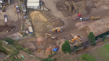 Aerial view of a construction site with diggers excavating the earth