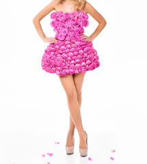 Beautiful woman in a dress of flowers. Pink roses.