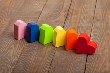 Lgbt. Bright paper hearts on wooden background