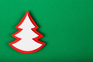 Background. Christmas tree paper cutting design card.