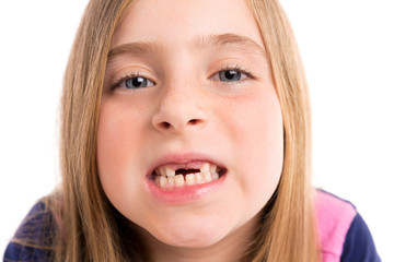 Blond indented girl showing teeth funny portrait