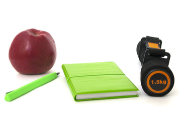 barbell apple and notebook isolated over white