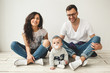 Young hipster father, mother and baby boy on wooden floor - 80539142
