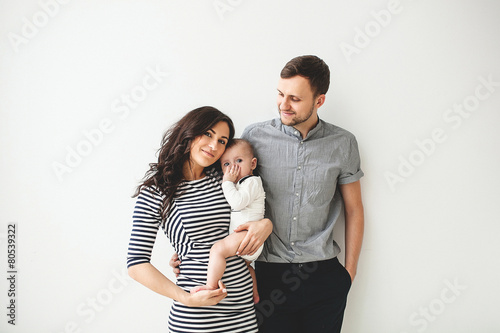 Happy young father mother and baby boy over white background - 80539322