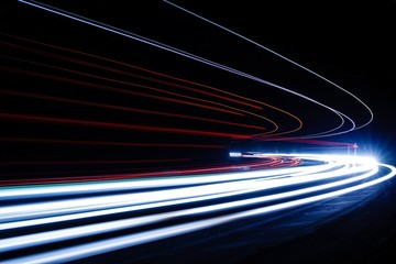 light trails in tunnel. Art image. Long exposure photo taken in