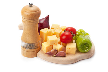 Mill , cheese and vegetables on wooden board