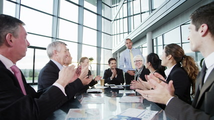 Diverse, happy business team in a meeting in contemporary office building