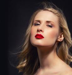 Beautiful Woman Dark Studio Portrait with red lips on black