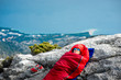 Woman in sleeping bag on the mountain - 80541507