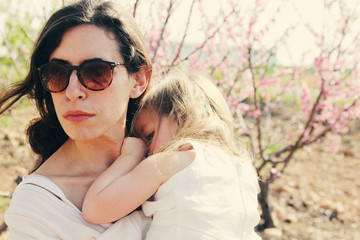 Portrait of happy loving mother and her daughter outdoors