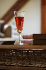 pink wine and old books on the table