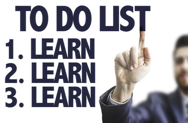 Business man pointing the text: To Do List - Learn