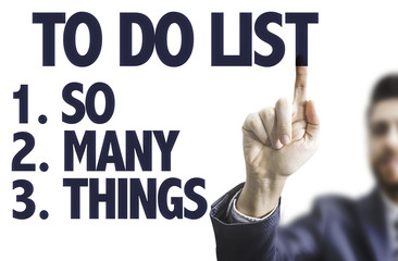 Business man pointing the text: To Do List - So Many Things