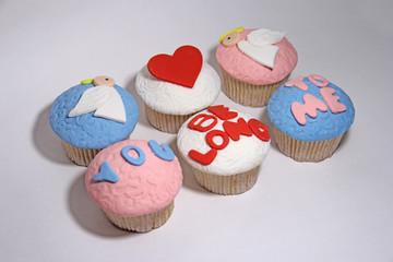 six sweet mastic cupcake on white