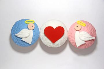 Three sweet mastic cupcake on white