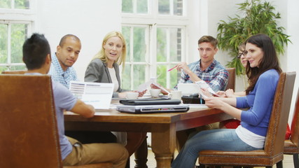 Attractive casual business team in relaxed company meeting