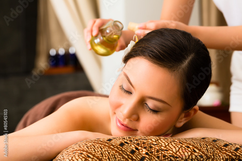 Chinese Woman at wellness massage with essential oils - 80545103