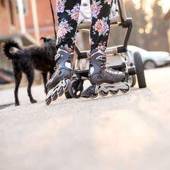 Woman Wearing Rollerblades Skating While Pushing Baby Stroller