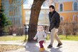 Father with his toddler son walking and playing outdoors