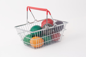 colorful painted Easter eggs in the basket for shopping