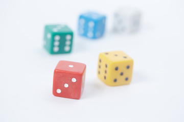 colored playing dice in a chaotic manner on a white background