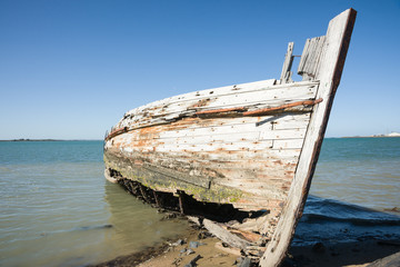Derelict oyster boat wreck on beach