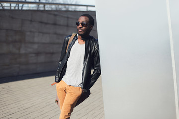 Street fashion concept - handsome stylish african man standing