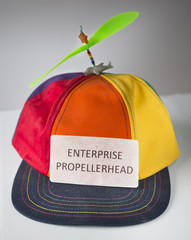 Colorful hat with green propeller with sign