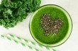 Green kale smoothie in glass with heart of chia seeds - 80549782