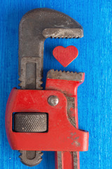 Troubled Love: Red Heart Squeezed by Wrench