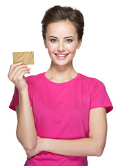 Young smiling woman holds credit card on white background