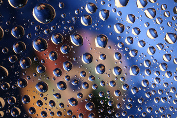 Water drops on plastic surface with refracted image