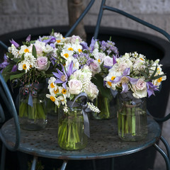 decoration of dining table. bouquet of white narcissus in vase o