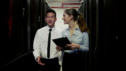 IT engineers in a data centre chatting as they work