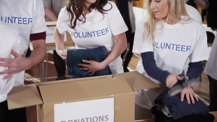 Charity volunteers sorting through donated goods