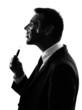 business man smoking electronic e-cigarette silhouette
