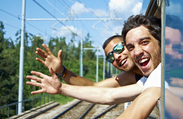 Two young enjoy a train ride