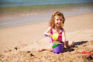 Happy girl having fun at the beach