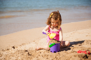 Girl building a sand castle